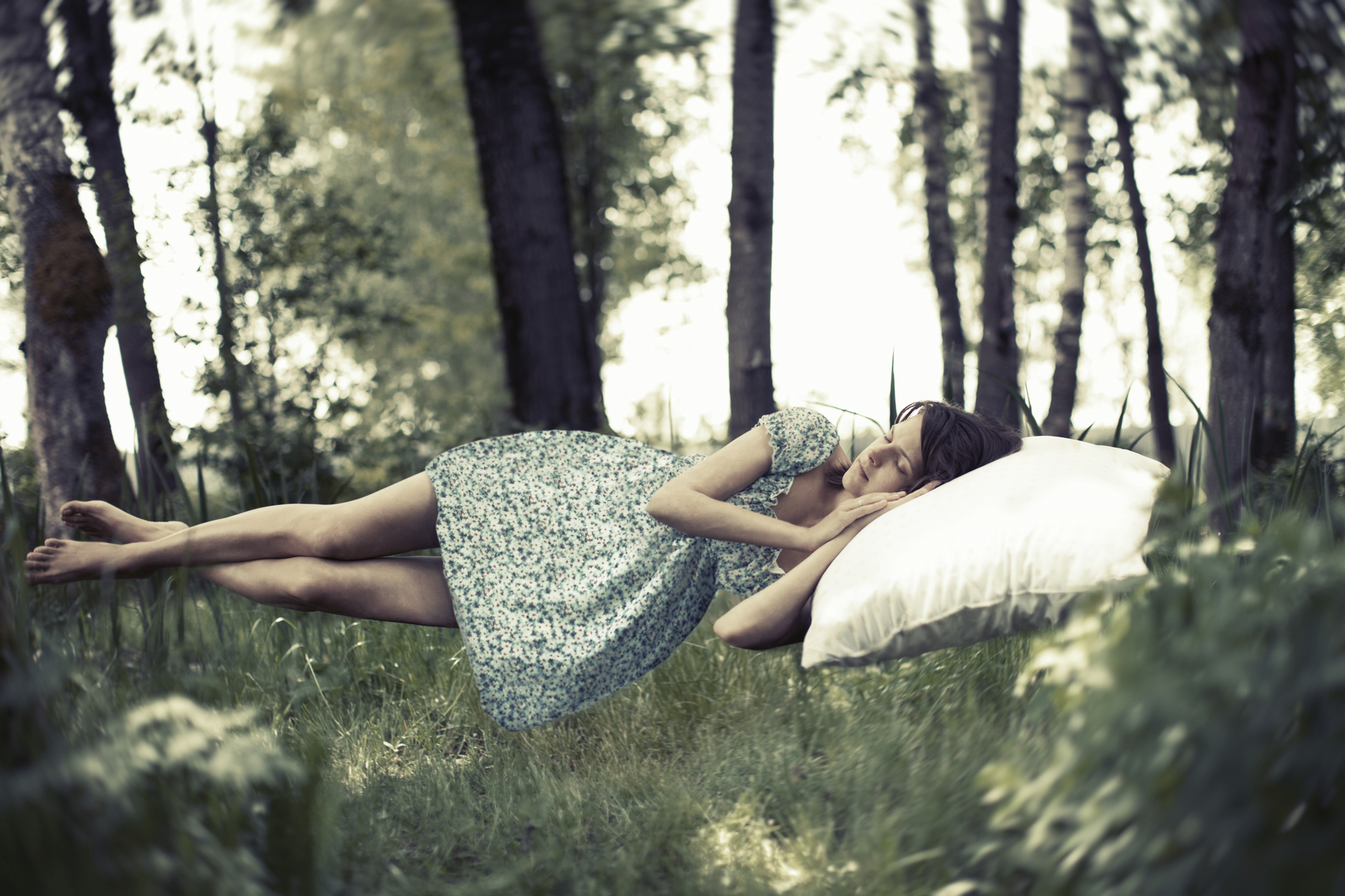 Young woman sleeping, toned image